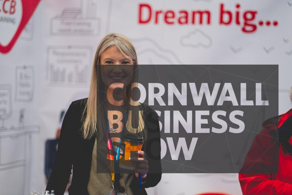Happy Cornwall Business Show exhibitor holding a Cornish Tea drink