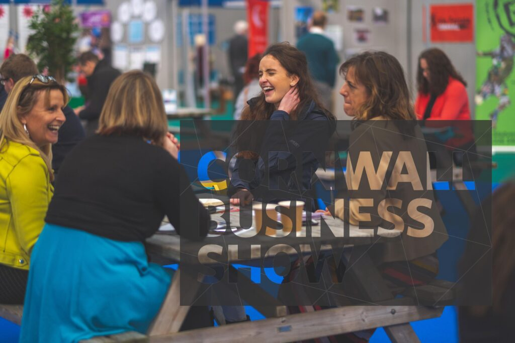 Happy Cornwall Business Show visitors making new contacts an expanding their business