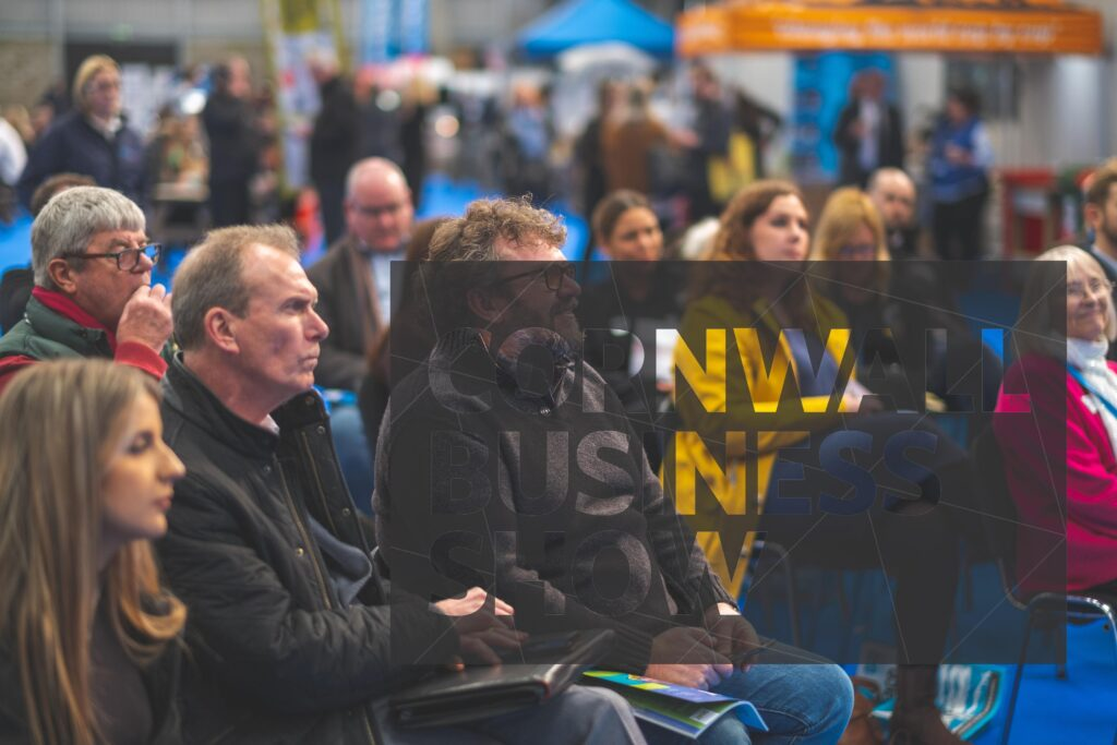 Cornwall Business Show visitors sat engaged and focused, listening to business-related seminars